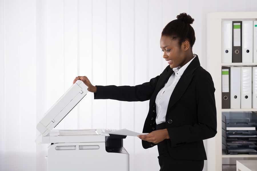 Business-Woman-Uses-Scanner-In-White-Office-Printer.jpg